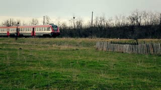 Train passing on the green field. Romania � circa 2010.
