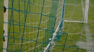 Ball enters the football goal net