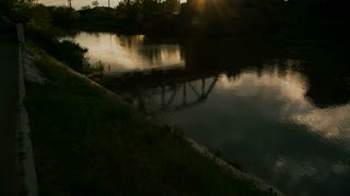 Bridge on the river at sunset