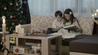 Children reading on Christmas Eve