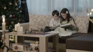 Children reading on Christmas Eve
