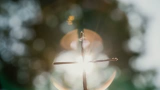 Christian cross from sticks in a beautiful bokeh background