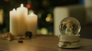 Christmas candles and glass globe