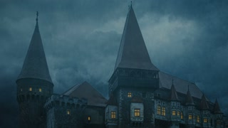 Corvin Castle in Transylvania on a stormy night - main towers