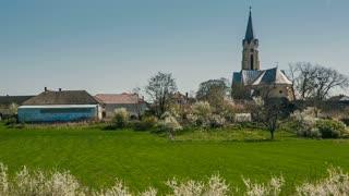 Country Catholic Church in Spring - pan shot