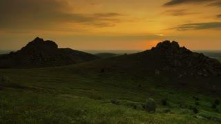 Cross on mountain peak at sunrise - panoramic view