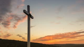 Cross on the hill at sunset - zoom out