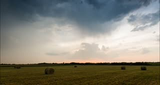 Dark clouds over an agricultural field - time lapse B