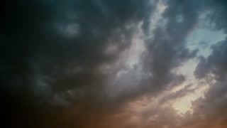 Flock of birds and dark clouds