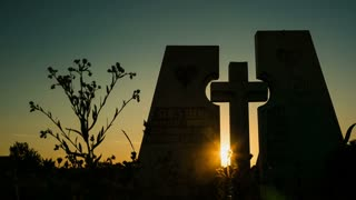 Funeral cross at sunset