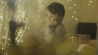 Happy child looking at Christmas lights