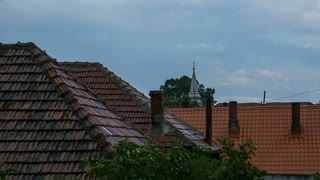 House roofs and church steeple after rain - MS