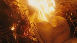 Incinerate open antique book in depth blue night
