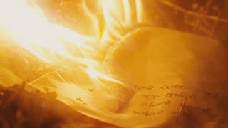 Incinerate open antique book with handwritten notes