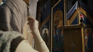 Inside of the Orthodox Church - woman praying
