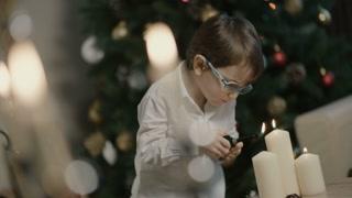 Little boy lightning Christmas candles
