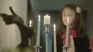 Little girls blew out the candles in the candlestick
