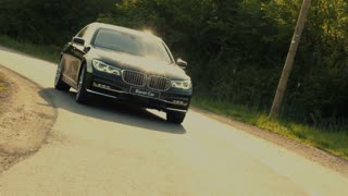 Luxury car driving on a countryside road