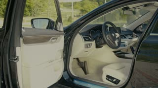 Luxury car interior - driver seat and dashboard
