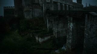 Medieval Castle at twilight on dark clouds atmosphere - tilt up