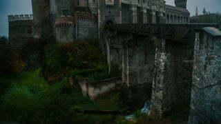 Medieval castle in Transylvania on a cloudy day - tilt up