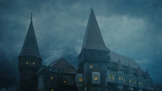 Medieval Castle in Transylvania on a stormy night - tilt down