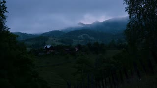 Mountain village and fog - time lapse