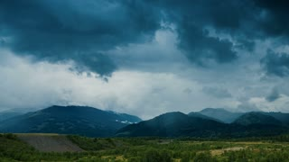 Mountains and dark clouds - pan shot