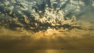 Mystical sunrise at Black Sea with clouds and sun rays
