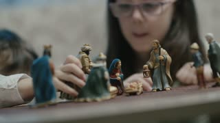 Nativity figurines and children playing