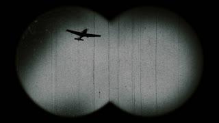 Old airplane through binoculars