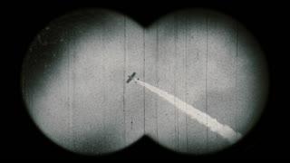 Old airplane with smoke through binoculars