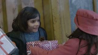 Poor children receiving Christmas presents