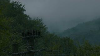 Rain clouds on a mountains landscape - time lapse