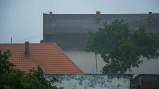 Rain cold over roofs