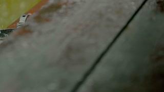 Rain falling in a pan - slo mo
