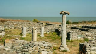 Ruins of the ancient Greek city of Histria with the Black Sea in background - pan shot