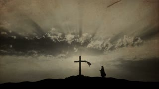 Silhouette of woman praying at Cross - old paper