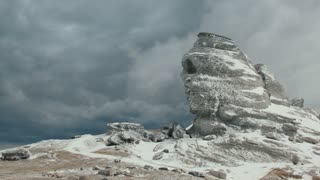 Sphinx rock formation in the Bucegi Mountains during winter