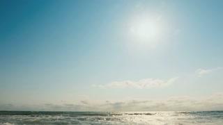 Sun, sea waves and sandy beach - tilt down