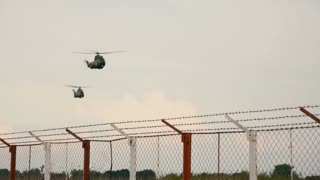 Two military helicopters - left side