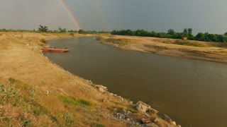 Two rainbows over the river