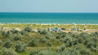 Wild beach with cars and tents at the Black Sea