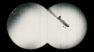 World War II era airplane with smoke falling