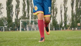 Young soccer running towards the camera - Low Angle