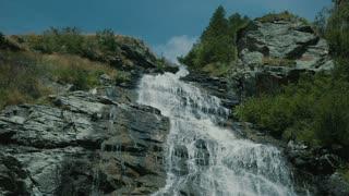 View of Capra Waterfall during summer in Fagaras Mountains, Romania.