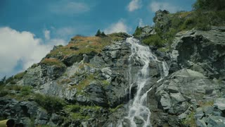 View of Capra Waterfall during summer in Fagaras Mountains, Romania.