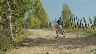 Young boy on bicycles at the countryside.