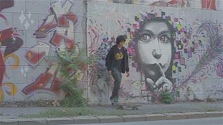 Young skater and graffiti 1