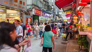 People walking through market, Wan Chai, Hong Kong, China